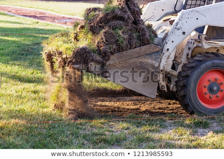 Small Bulldozer Removing Grass From Yard Preparing For Pool Inst Stock photo © feverpitch