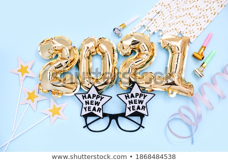 Golden balloons in form of star, happy new year Stock photo © MarySan
