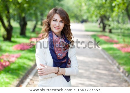 Portrait of a lovely young girl with long brunette hair s Stock photo © deandrobot
