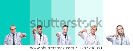 Doctor Showing Thumb Down Sign Stock photo © AndreyPopov