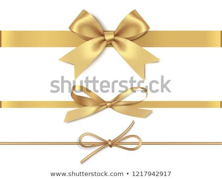 dourado · arco · seda · fita · isolado · branco - foto stock © olehsvetiukha