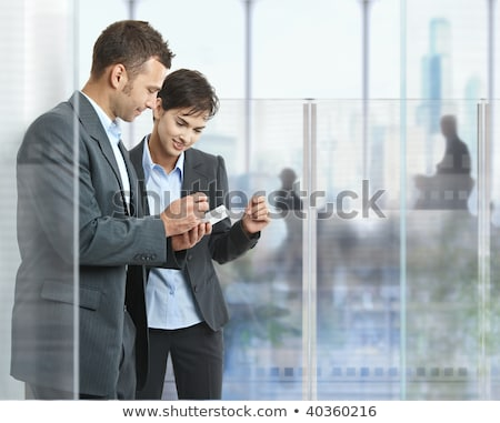 Two businessman using smart phone Stock photo © Kzenon