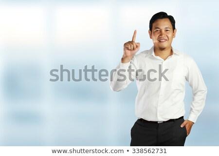 Glimlachend elegante man tonen wijzend arm Stockfoto © feedough