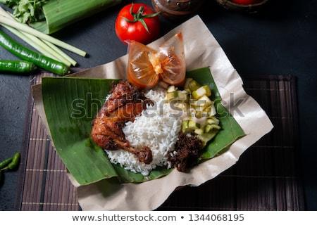 Nasi lemak kukus with fried chicken stock photo © szefei