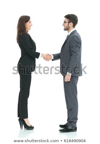 woman looking at businessmen shaking hands stock photo © andreypopov