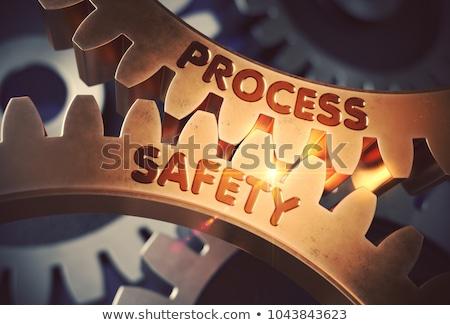 Work Safety On Golden Metallic Cogwheels 3d Illustration Foto stock © Tashatuvango