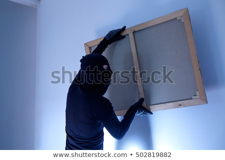 a thief steals a painting Stock photo © studiostoks