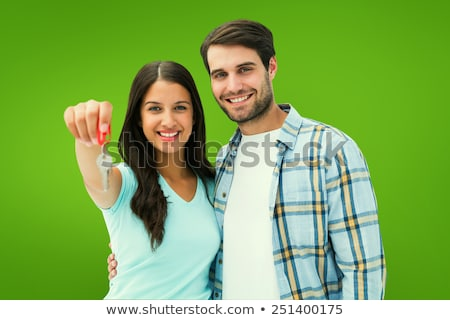 Man Holding key in front of vignette Stock photo © wavebreak_media