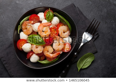 Fresh caprese salad with shrimps Stock photo © karandaev