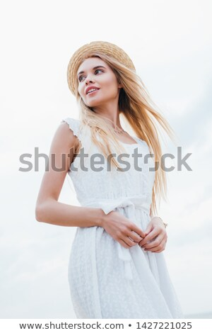 Low angle view of woman in hat standing on the beach Stock photo © wavebreak_media