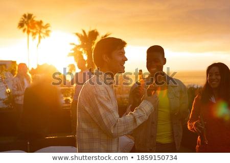 Elöl kilátás többnemzetiségű barátok élvezi tengerpart Stock fotó © wavebreak_media