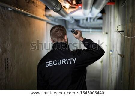 Biztonsági őr áll pince hátsó nézet tart elemlámpa Stock fotó © AndreyPopov