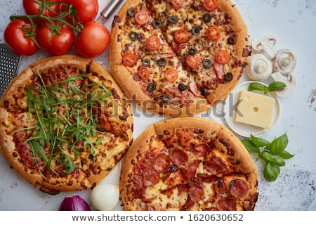 Three american style pizzas served on a table Stock photo © dash