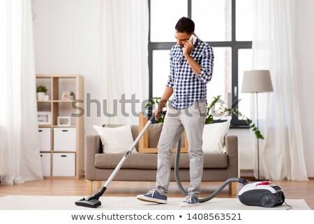 человека пылесос призыв ячейку домой домашнее хозяйство Сток-фото © dolgachov