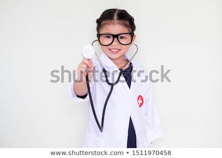 Diversión nina hasta médico enfermera Foto stock © Giulio_Fornasar