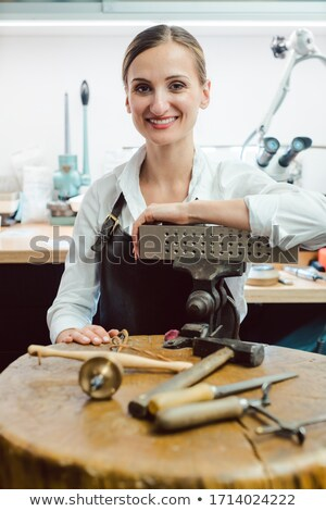 Jewelry designer in her workshop boating with her tools Stock photo © Kzenon