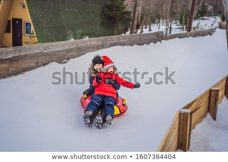 mom son ride on an inflatable winter sled tubing. Winter fun for the whole family BANNER, LONG FORMA Stock photo © galitskaya