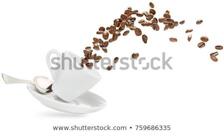 Tasse soucoupe grains de café isolé blanche café Photo stock © Evgeniya_Uvarova