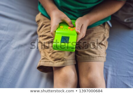 Hands holding portable games console  Stock photo © adrian_n