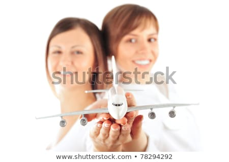 Stock photo: Portrait of two young happy women stewardess holding jet aircraf