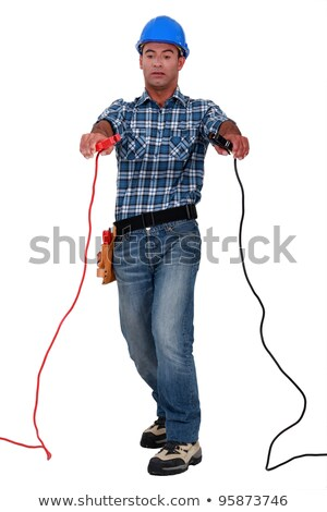 Tradesman holding jumper cables Stock photo © photography33