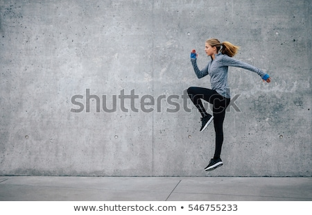 young woman doing exercises outdoors Stock photo © photography33