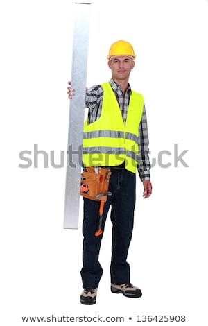 Tradesman holding up a steel girder Stock photo © photography33