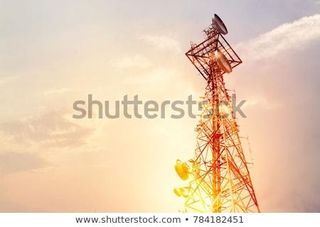 Stock photo: Communication antenna silhouette at sunset.