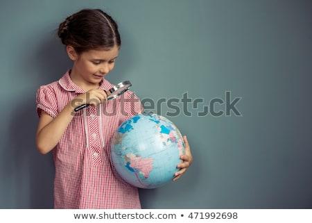 девочку увеличительное стекло мира стороны ребенка земле Сток-фото © photography33