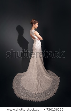 Lovely young fiancee blonde posing in nuptial white dress Stock photo © gromovataya