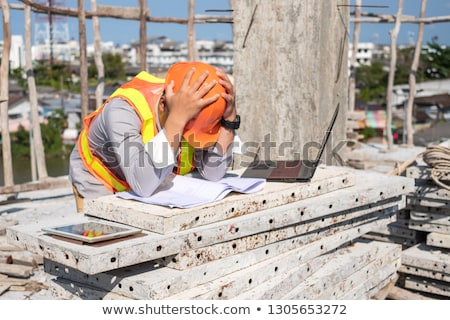Frustrated construction worker with a laptop Stock photo © photography33