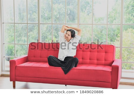 attractive red haired female stretching in the living room in her appartment stock photo © wavebreak_media
