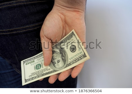 Businessman counting banknotes against a white background stock photo © wavebreak_media