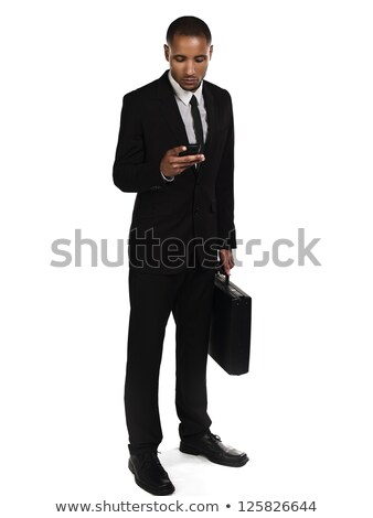 Businessman sending a text message against a white background Stock photo © wavebreak_media