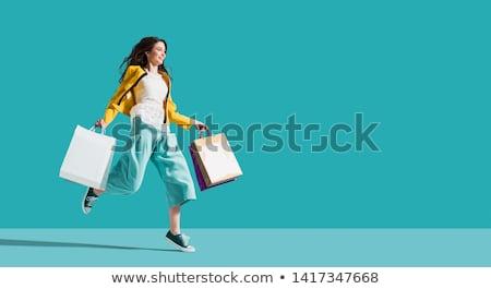 Vásárló boldog nő rózsaszín bevásárlótáskák fehér Stock fotó © dolgachov