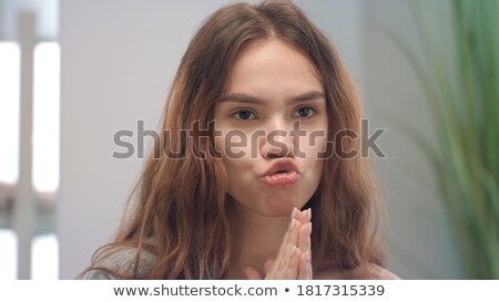 Grimacing woman Stock photo © timbrk