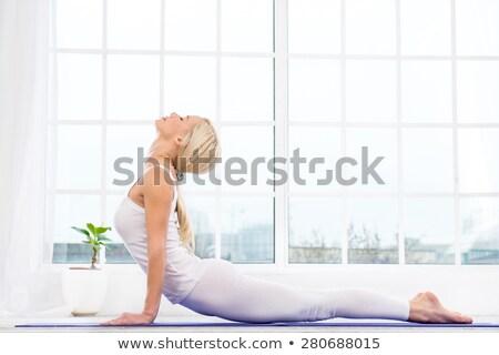 Fiatal nő nyújtott test fiatal fitnessz nő fehér Stock fotó © williv