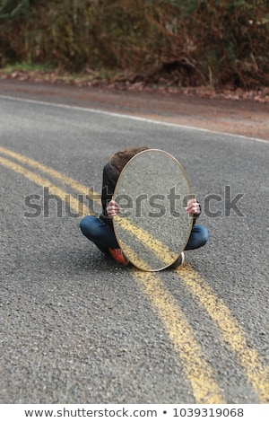 Person Hides Behind a Yellow Square Stock photo © Nelosa