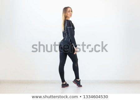 Beautiful fitness woman looking back Stock photo © stockyimages