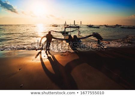 Pescador aldeia bali nascer do sol tradicional barco Foto stock © joyr