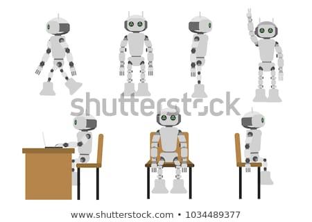 Robot oturmak dizüstü bilgisayar yalıtılmış beyaz mutlu Stok fotoğraf © Kirill_M