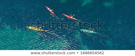 Teenagers in sea with canoe Stock photo © monkey_business