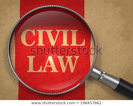 Civile legge lente di ingrandimento vecchia carta rosso verticale Foto d'archivio © tashatuvango
