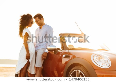 Happy interracial couple standing together outdoors Stock photo © jarenwicklund