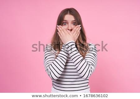 Ritratto felice donna coprire bocca mani Foto d'archivio © deandrobot
