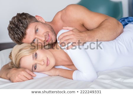 Very Happy Woman Lying on Bed Stock photo © juniart