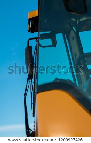 Citromsárga hidraulikus kotrógép közelkép részlet izolált Stock fotó © rekemp