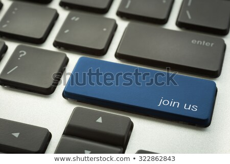 laptop keyboard with typographic join us button stock photo © vinnstock
