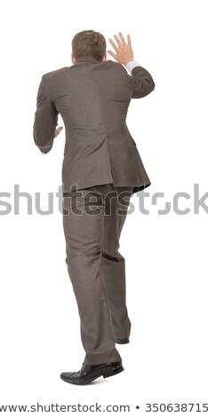 üzletember toló üres hely hátsó nézet izolált fehér Stock fotó © cherezoff