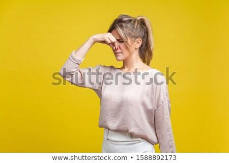 szőke · nő · ujj · orr · szürke · lány - stock fotó © feverpitch